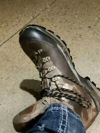 pair of black leather boots Abbotsford, V4X 1H5
