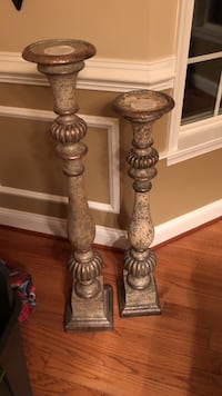 two gray wooden candle holders