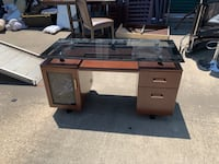 Brown glass and wooden desk... Grover, 28073