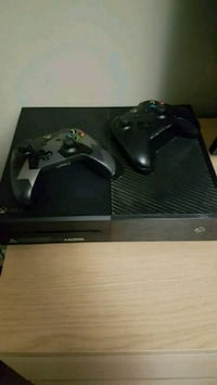 black Xbox One console with 2 controllers Toronto