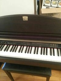 black, white, and brown electronic keyboard Sterling, 20164