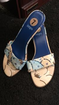 pair of white leather sandals