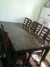 rectangular brown wooden table with six chairs dining set Burnaby, V3N 1Z3