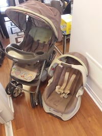 baby's gray and pink travel system