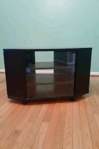 TV stand with glass door and side shelves