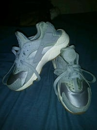 pair of gray Nike Huarache shoes 50 km