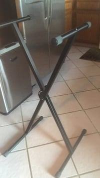 black electronic keyboard stand