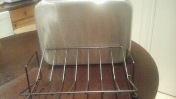 Stainless steel roasting pan with cooking  rack