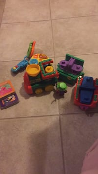 Lot of baby toys and books. Sesame Street books, fisher price train with monkey, vetch keys, with music and sound and working batteries. All for only $10! Check my other listings!! Laval, H7Y 2C1