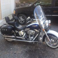 2006 Harley Davidson softail Deluxe twin V 5 sp trans  fuel injected. Has hard leather bags  touring seat with back rest  full windshield. Added tach  front crash bar   16k miles garage kept   White pearl and blue pearl  paint   Must see. Serious buyers o 36 km