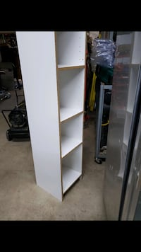 Tall white bookcase/cabinets
