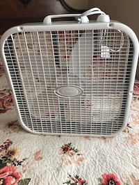 white and gray metal pet cage