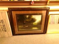 green tree painting with brown frame