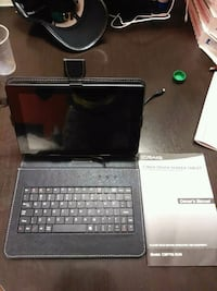 black tablet computer with keyboard 25 km