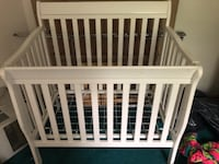 baby's white wooden crib East Northport