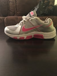 red, gray, and white Nike low-top sneakers