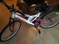 white and red Huffy full suspension mountain bike