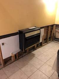 Propane wall heater with ceramic logs.  Already removed from wall.
