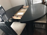 Dinning set with four chais, converts from round to oblong table by flipping the insert!  It must go immediately we are moving! $100 if you buy today! Herndon, 20171