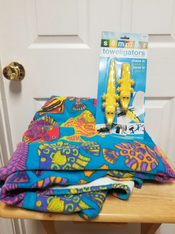 Beach towel with towel clamps