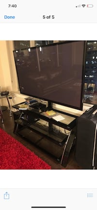 Black flat screen tv with black metal tv stand Denver, 80202