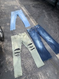 Men damaged jeans has holes in them selling all together for 15.00 Hyattsville, 20784