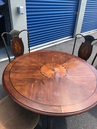 round brown wooden dining table set