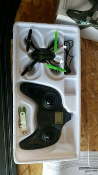 white and green quadcopter drone with box San Diego, 92123