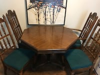 """Solid oak table with four chairs, perfect for cards or game nights. 27""""H, 44"""" wide also comes with two extension leafs Spokane Valley, 99016"""