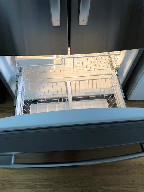 Whirlpool stainless steel French door refrigerator  7a07f865-f1ea-489e-84c9-e3250e3bd0eb