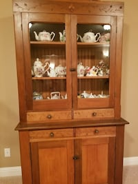 brown wooden glass display cabinet