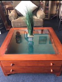 brown wooden framed glass top coffee table Kissimmee, 34741