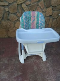 white and blue high chair