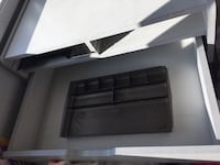 gray drawer with slots for paper