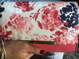 Charming Charlie floral clutch