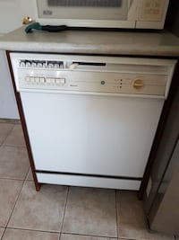 white GE dishwasher built in Midhurst, L0L 1X1