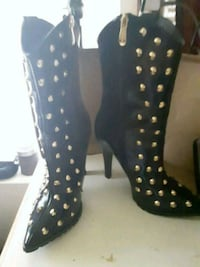 pair of black leather knee-high boots Harker Heights