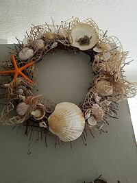 beige and brown shell wall wreath