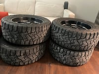33 by12.50 r20 Toyo Open Country Chevy or GMC tires.With Pro Comp rims
