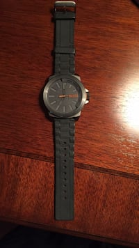 Round black analog watch with black strap Laval, H7C 2T9