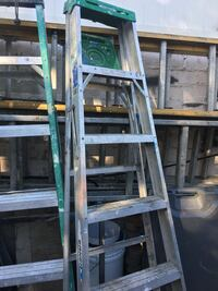 Gray and green a-frame ladder
