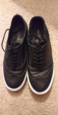 pair of black tennis shoes Jacksonville, 32244