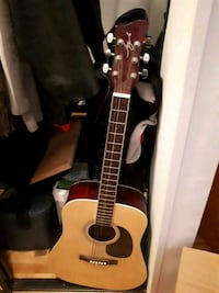 brown and black acoustic guitar 777 km