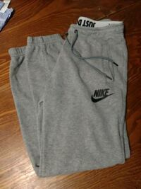 gray and black Nike sweatpants null