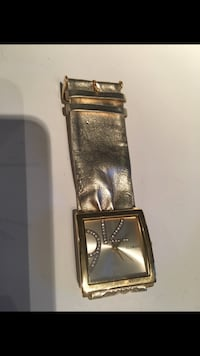 rectangular gold analog watch with gold link bracelet