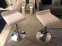 2 white and chrome bar stools