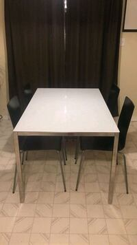 rectangular white glass table with four chairs St. Catharines, L2R