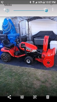 Ariens tractor with snowblower attachment and grass cutting deck