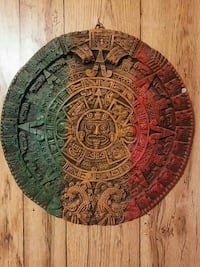 green, brown, and red Aztec calendar Brownsville