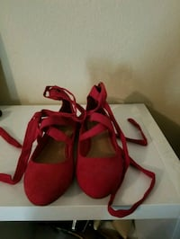 pair of women's red suede strappy flat shoes